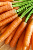 Carrots bunch on wood Stock Photos