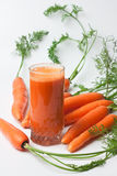 Carrots and carrot juice Stock Images