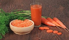 Carrots and carrots juice Royalty Free Stock Photos