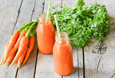 Carrots and carrots juice Stock Image