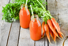 Carrots and carrots juice Stock Images