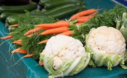 Carrots and cauliflower on a market Stock Photos