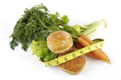 Carrots with Celery and Doughnuts Stock Photo