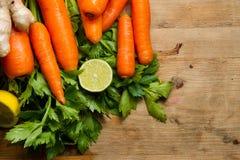 Carrots, celery, ginger and lemon Stock Photo