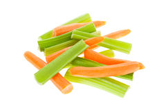 Carrots and celery isolated. A pile of carrots and celery isolated on white Royalty Free Stock Images