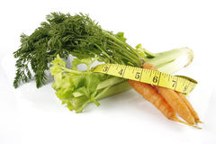 Carrots with Celery and Tape Measure Stock Photo