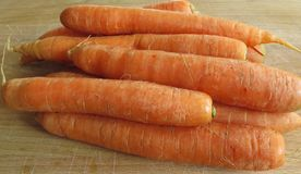 Carrots. On a chopping board Royalty Free Stock Images