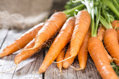 Carrots (close-up shot). Some fresh Carrots on wooden background (close-up shot Royalty Free Stock Images