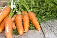 Carrots (close-up shot). Some fresh Carrots on wooden background (close-up shot Royalty Free Stock Photos