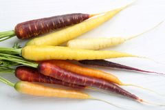 Carrots. Colorful carrots on a wooden white background Stock Photo