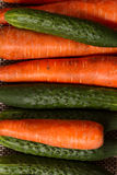 Carrots and cucumbers close-up. Healthy food. Fresh vegetables from the garden Stock Photography