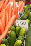 Carrots and cucumbers for sale. Organic carrots and cucumbers for sale at the farmers's market Stock Photo