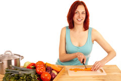 Carrots cut. A young woman cuts a carrot stock photo