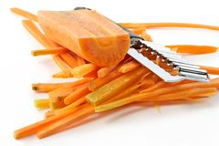 Carrots cut by slices and a knife Stock Image