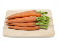 Carrots on cutting board Royalty Free Stock Photo