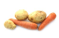 Carrots and an early potato. Vegetables on a white background, carrots and an early potato Stock Photography