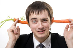 Carrots in ears Stock Photo