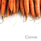Carrots in a frame row,  on a white background, close up Stock Photos