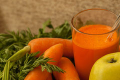Carrots and freshly squeezed carrot juice in a glass Royalty Free Stock Photography