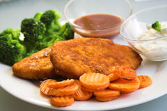 Carrots, fried meat.broccoli. A balanced meal royalty free stock photography