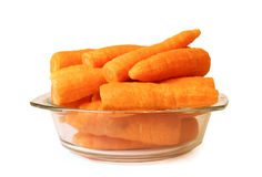 Carrots in a glass plate. Isolated on the white background Royalty Free Stock Photos