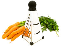 Carrots and grater Royalty Free Stock Images