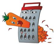 Carrots and grater. Angry grater grinds orange carrots Royalty Free Stock Photo