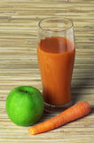 Carrots, green apple and juice Royalty Free Stock Image