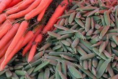 Carrots and green beans. Pile of carrot and green beans on the street market Stock Photo