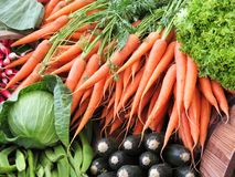 Carrots in green grocery Stock Photos