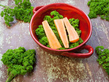 Carrots with green leaves on a wooden background Stock Images