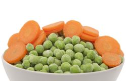 Carrots and green peas Royalty Free Stock Image