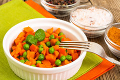 Carrots and green peas on a couple of Diet Stock Photos