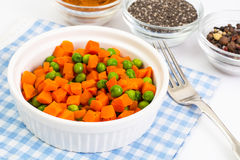 Carrots and green peas on a couple of Diet Royalty Free Stock Images
