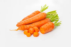 Carrots heap and slices Stock Images