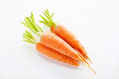 Carrots heap in white background 2 Stock Photo
