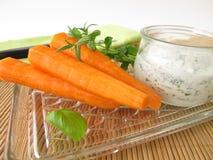 Carrots and herb yogurt Royalty Free Stock Image