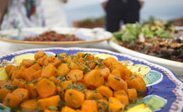 Carrots with herbs and butter or oil at an italian buffet Royalty Free Stock Image
