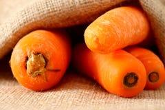 Carrots hessian sack 4 Stock Photography