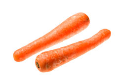Carrots isolated on a white Stock Photos