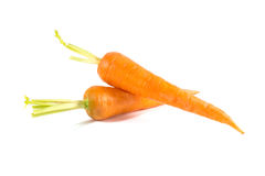 Carrots isolated on white. Heap of carrots isolated on white background Stock Photos