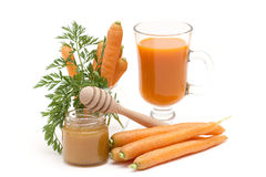 Carrots juice, fresh carrots and honey Royalty Free Stock Photo