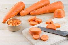 Carrots and knife on wooden cutting board Stock Photography