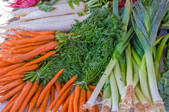 Carrots, leeks and herbage. For sale at a market Stock Photos