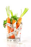 Carrots in a measuring cup Royalty Free Stock Images