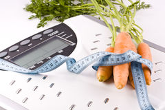 Carrots and measuring objects Royalty Free Stock Image