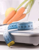 Carrots and measuring objects Royalty Free Stock Photos