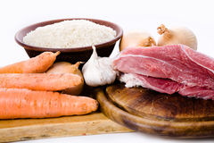 Carrots, meat, onions and rice Royalty Free Stock Photo