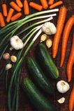 Carrots, onion, garlic and cucumber diet organic Royalty Free Stock Photos