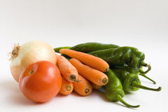 Carrots, onion, tomato and peppers Stock Image